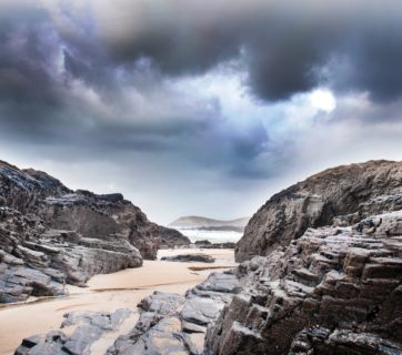 beach-cliffs-clouds-912472