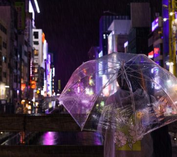 selective-focus-photo-of-a-person-carrying-umbrella-940034