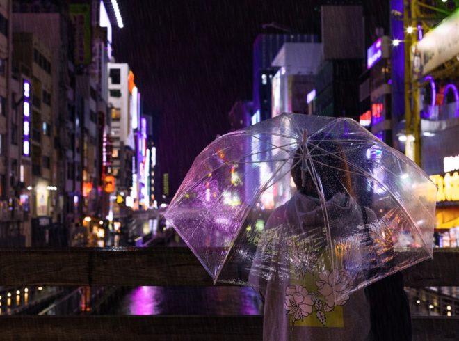 selective-focus-photo-of-a-person-carrying-umbrella-940034
