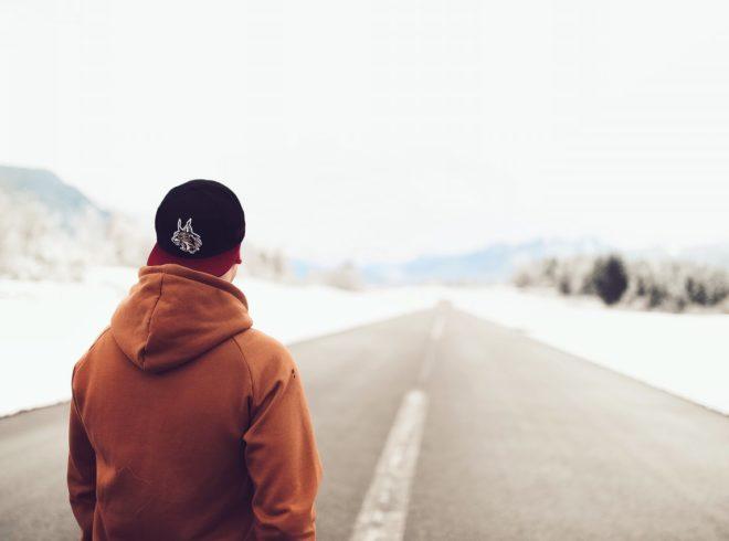 person-in-brown-hoodie-standing-on-asphalt-road-713072