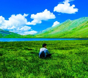 boy-sitting-on-green-grass-field-713058