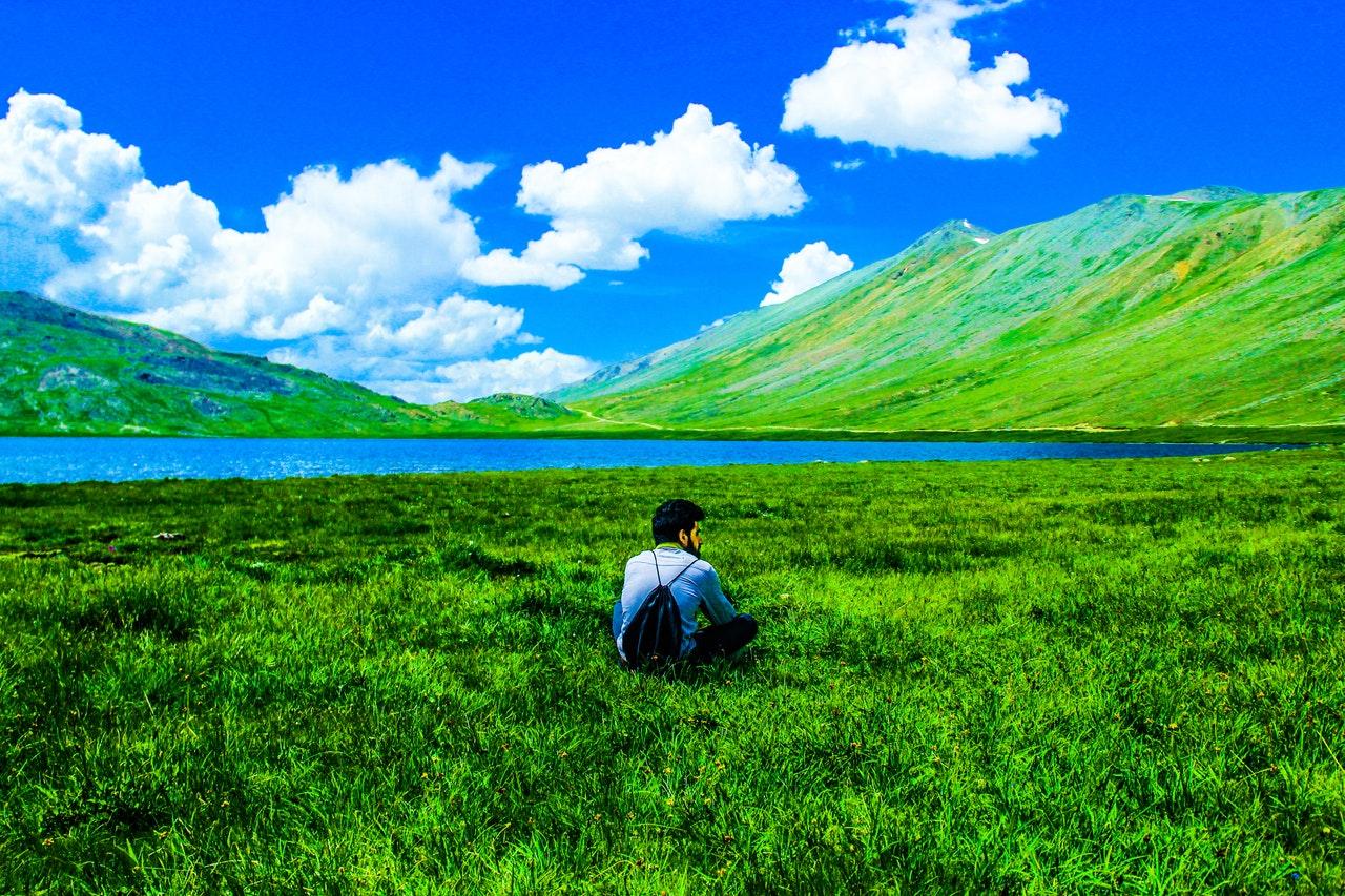 boy-sitting-on-green-grass-field-713058
