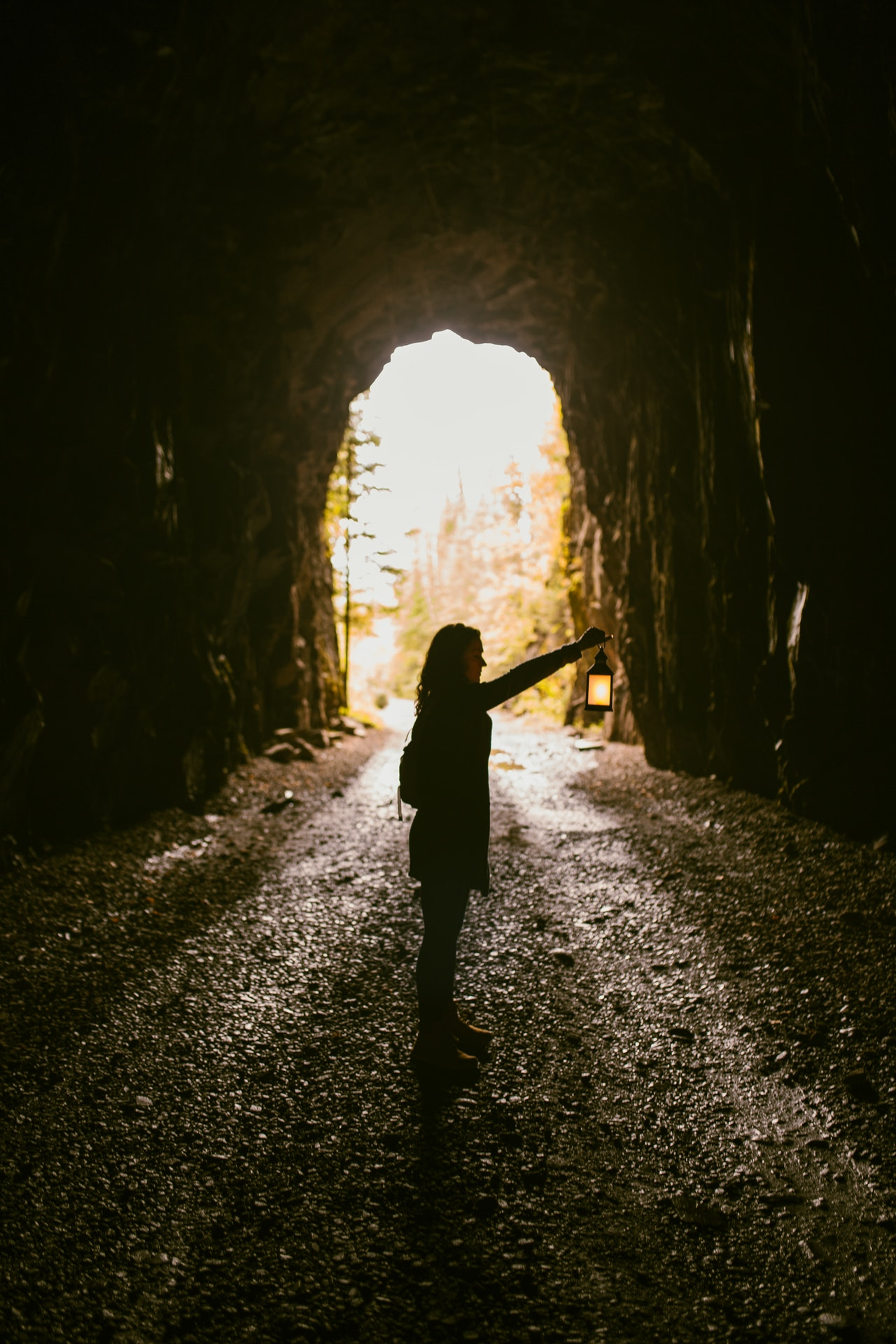 woman-standing-inside-cave-2883954